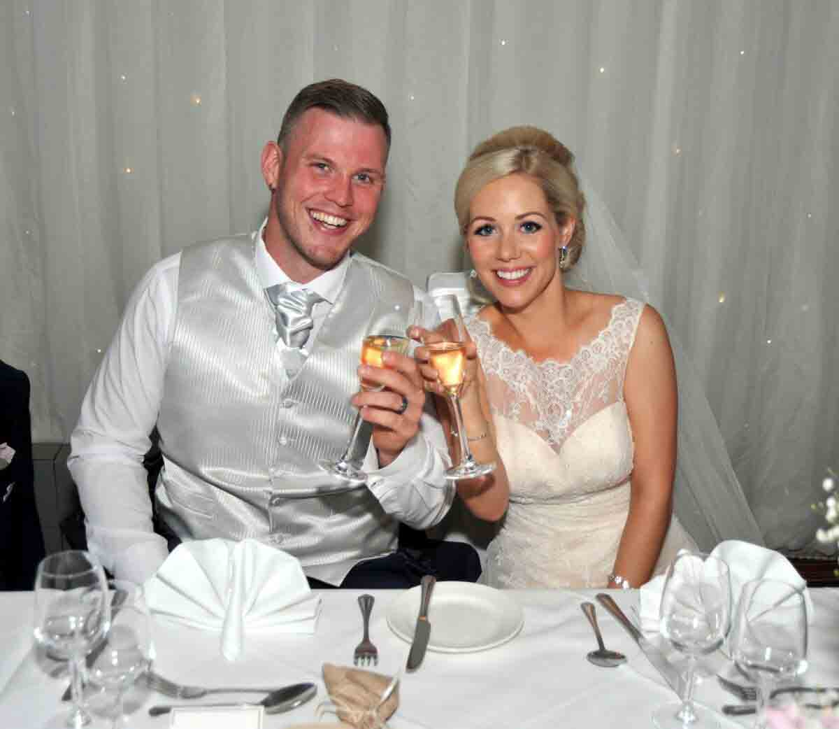Happy couple toasting with champagne